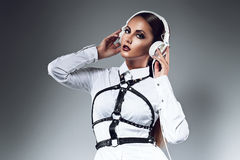 Hot woman with white headphones Stock Images