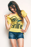 Hot woman in yellow t shirt. In studio Royalty Free Stock Photos