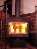 Hot wood stove. Having a hot fire in the wood stove Stock Photos