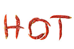 HOT. Word with dried red hot chili pepper isolate on white background Stock Photography
