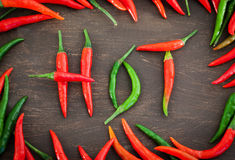 Hot word made from red and green chili pepper Stock Photography