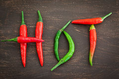 Hot word made from red and green chili pepper Stock Images