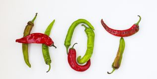 Hot word made from red and green hot chili pepper on white background royalty free stock photo