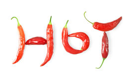 Hot written with chili peppers on white Stock Image