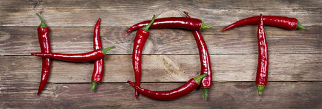 Hot written with chili peppers Royalty Free Stock Photos