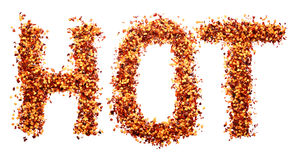 HOT written in crushed red pepper Royalty Free Stock Photography