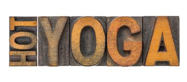 Hot yoga word abstract in wood type. Hot yoga word abstract - isolated text in letterpress wood type printing blocks stained by color inks stock photos