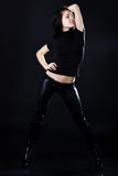 Hot young brunette in black leather pants Stock Photography