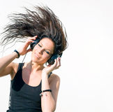 Hot young brunette musiclover. Royalty Free Stock Images