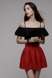Hot young brunette in red skirt and black blouse Royalty Free Stock Photo