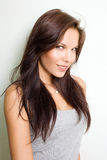 Hot young brunette smiling at the camera. Royalty Free Stock Photo