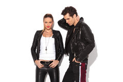 Hot young couple in leather clothes Stock Photos