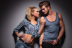 Hot young couple looking at each other Stock Images