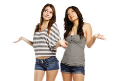 Hot young female friends gesturing on white Stock Images