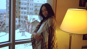 Hot young lady with dark hair is wraped in blanket looking at the camera and flirting. Young lady with dark hair is wraped in blanket looking at the camera and stock video footage
