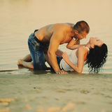 Hot young sensual couple. At the beach, summertime Royalty Free Stock Images