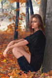 Hot young woman in autumn park Stock Photography