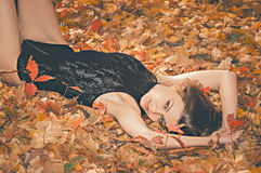 Hot young woman in autumn park Royalty Free Stock Photography
