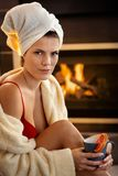Hot young woman and fireplace Stock Image