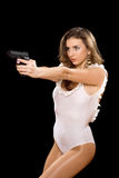 Hot young woman holding a gun Stock Photo