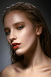 Hot young woman model with bright red lips makeup, strong e stock image