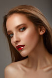 Hot young woman model with sexy bright red lips makeup, strong e Royalty Free Stock Photography