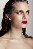 Hot young woman model with sexy bright red lips makeup Royalty Free Stock Image