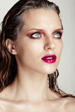 Hot young woman model with sexy bright red lips makeup Stock Photography