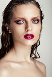 Hot young woman model with sexy bright red lips makeup Stock Photo