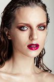 Hot young woman model with sexy bright red lips makeup Royalty Free Stock Images