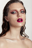Hot young woman model with sexy bright red lips makeup Stock Image