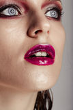 Hot young woman model with bright red lips makeup Royalty Free Stock Image