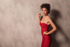 Hot young woman in a red short dress posing Royalty Free Stock Photos