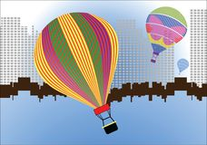 Hotair balloons over pixilated cityscape Stock Image