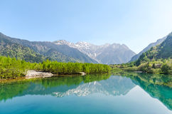 Hotaka mountain range reflect on taisho ike pond at kamikochi nagano japan. Hotaka mountain range reflect on taisho ike pond in spring at kamikochi national park stock photography