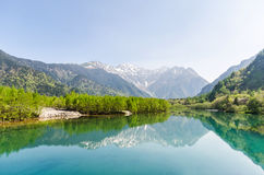 Hotaka mountain range and taisho ike pond in spring at kamikochi nagano japan. Hotaka mountain range and taisho ike pond in spring at kamikochi national park Stock Photography