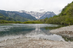 Hotaka mountain range and taisho ike pond in spring at kamikochi national park nagano. Japan Royalty Free Stock Photos