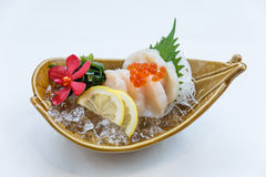 Hotate Sashimi : Raw Scallop Served with Ikura Salmon Roe with Sliced Radish and Lemon.  Stock Photos