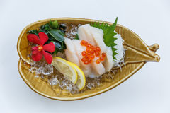 Hotate Sashimi : Raw Scallop Served with Ikura Salmon Roe with Sliced Radish and Lemon.  Royalty Free Stock Photo
