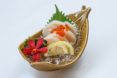 Hotate Sashimi : Raw Scallop Served with Ikura Salmon Roe with Sliced Radish and Lemon.  Royalty Free Stock Photos