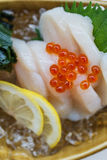 Hotate Sashimi : Raw Scallop Served with Ikura Salmon Roe with Sliced Radish and Lemon.  Royalty Free Stock Images