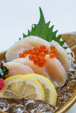 Hotate Sashimi : Raw Scallop Served with Ikura Salmon Roe with Sliced Radish and Lemon.  Stock Photo