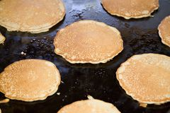 Hotcakes on a griddle. Hotcakes pancakes on a large griddle Stock Photography