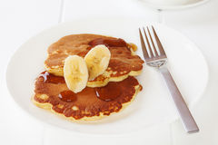Hotcakes with Maple Syrup and Banana Stock Photography