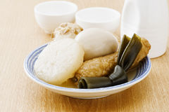Hotchpotch and sake. On the wooden table stock photography