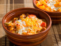Hotchpotch. With vegetables and eggs - this is traditional Bulgarian dish called giuveche stock photography