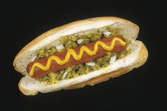 Hotdog. And bun  with relish, onions and mustard Stock Photo