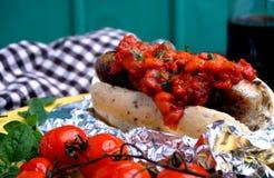 Hotdog with bacon and tomato sauce Stock Photos