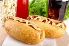 Hotdog with bottle of mustard and ketchup with drink cola,popcor Stock Photo