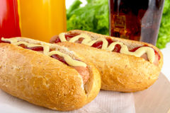 Hotdog with bottle of mustard and ketchup with drink cola on woo Royalty Free Stock Image